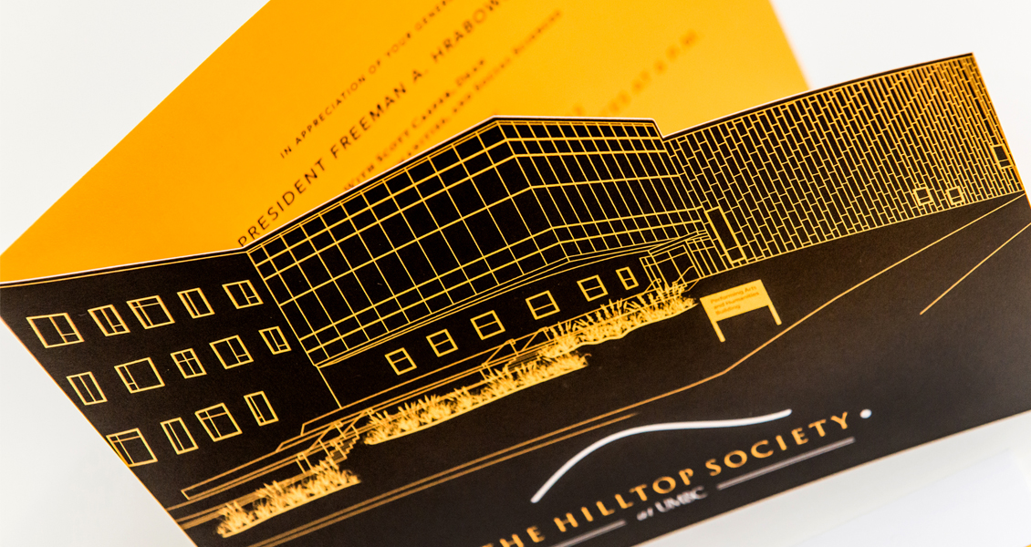 Close up of Hilltop Society die cut invitation